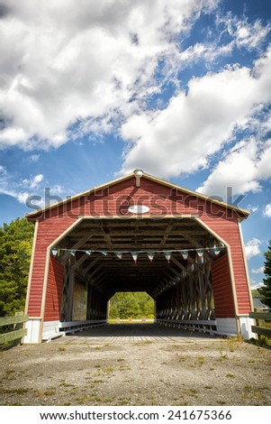The Pont Romain Caron, covered Bridge, in St John de la Lande, Temiscouata, Quebec province. Historical monument dating back to 1940. - stock photo