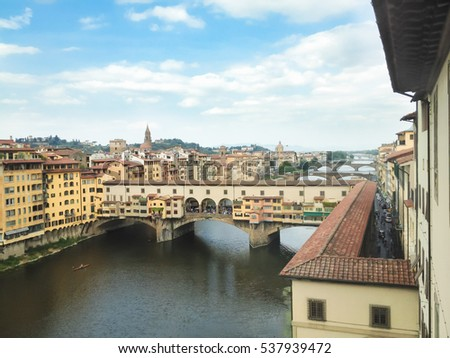 The Ponte Vecchio is a medieval stone arch bridge over the Arno River, in Florence, Italy, noted for still having shops built along it, as was once common.