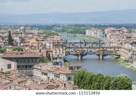 The Ponte Vecchio (Old Bridge), a Medieval stone closed-spandrel segmental arch bridge over the Arno River in Florence, Italy.