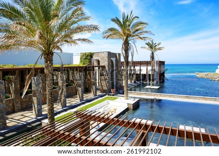 The pools and beach at luxury hotel, Crete, Greece - stock photo