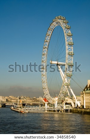 The popular tourist attraction, the London Eye, beside the River Thames