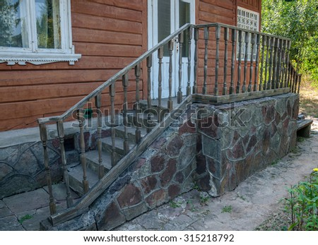 The porch of the old house with decorative railings,Ukraine - stock photo