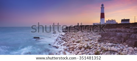 The Portland Bill Lighthouse on the Isle of Portland in Dorset, England at sunset. - stock photo