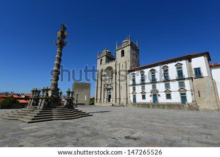 The Porto Cathedral (Portuguese: S�© do Porto) and Manueline Pillory at Terreiro da S�©, Porto, Portugal. Porto Old City is registered as the UNESCO World Heritage Site. - stock photo