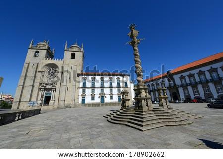 The Porto Cathedral (Portuguese: Se do Porto) and Manueline Pillory at Terreiro da Se, Porto, Portugal. Porto Old City is registered as the UNESCO World Heritage Site. - stock photo