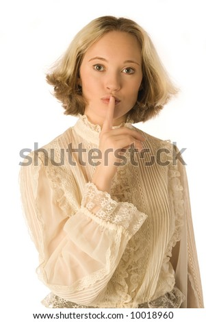 The portrait of a woman with her finger near her lips - stock photo