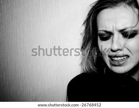 The portrait of crying girl. Great pain. - stock photo