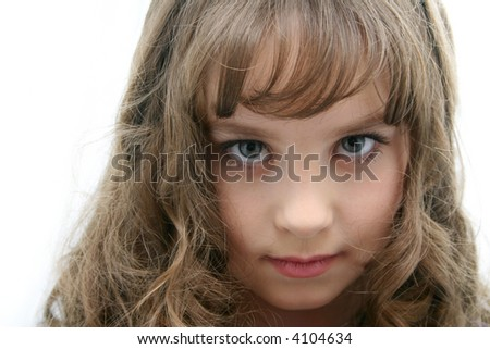 The portrait of the girl of the teenager with long hairs on light background. - stock photo