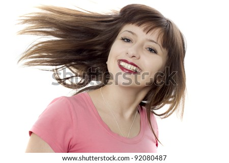 The portrait of the girl on a white background which smiles - stock photo