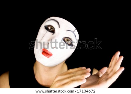 The portrait of the mime on a black background