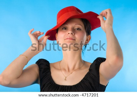 the portrait of woman in red hat on blue background