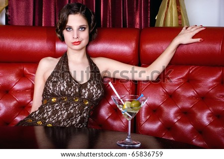 The posing girl at restaurant in style old-fashioned - stock photo