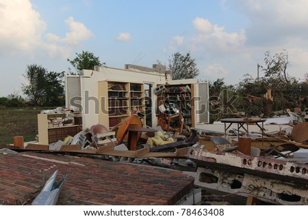 The power of nature's fury, as well as it's perplexity, is displayed in this image of books still on their shelves while the building that housed them succumbed to 200+ mph winds of a EF5 tornado. - stock photo