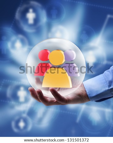 The power of social networking media concept - radiating icon in human hand - stock photo