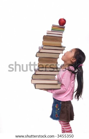 The power of the future is your education. A young girl hold a tall tower of books. The weight of education. - stock photo