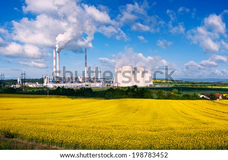 the power station Pocerada with rape field - stock photo