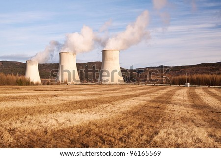 the power station Prunerov and winter field - stock photo