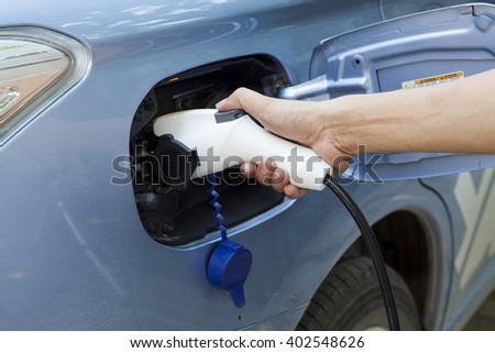 The power supply for Charging of an electric car - stock photo