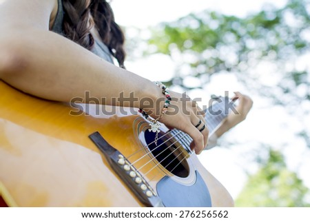 The practice of playing the guitar.Women playing guitar. - stock photo
