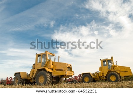the preparation of land for growing crops with heavy agriculture tractors and Disc harrows - stock photo