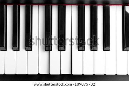 the pressed chord on white piano keys - stock photo