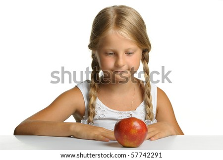 The pretty girl wishes to eat an apple. It is isolated on a white background - stock photo
