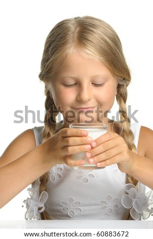 The pretty girl with a glass of milk. It is isolated on a white background - stock photo