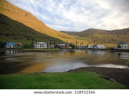 The pretty village of Seydisfjordur early in the morning sun Eastern Iceland - stock photo