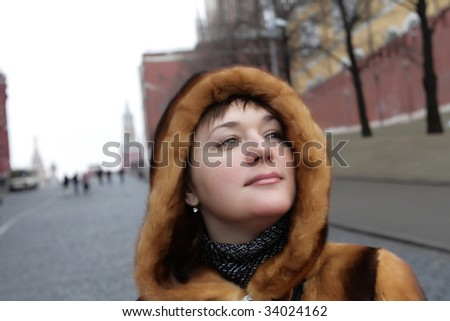 The pretty woman poses in Moscow Kremlin