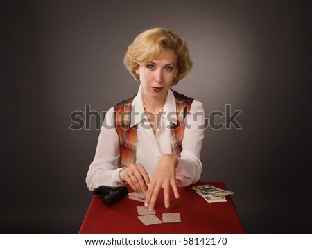 The pretty woman with poker cards - stock photo