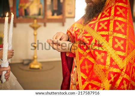 The priest in a smart attire carries out ceremony. - stock photo
