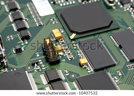 The printed-circuit-board with computer chips resistors and condensers