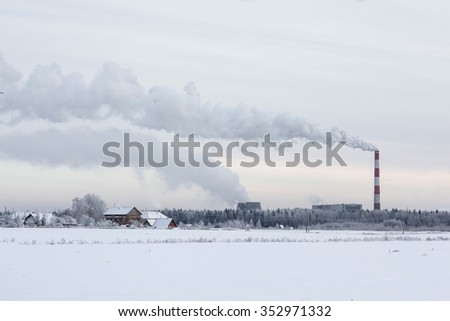 The problem of air pollution. The smoke from the chimney into the sky. Environmental pollution. - stock photo