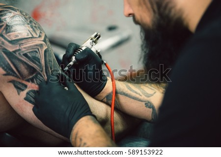 Process creating tattoo on back man stock photo 589153922 for Process of tattooing