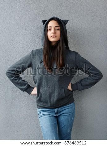 the proud teenager girl hands on waist - stock photo