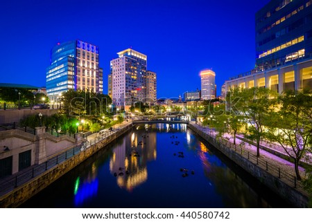 The Providence River and modern buildings at night, in downtown Providence, Rhode Island.