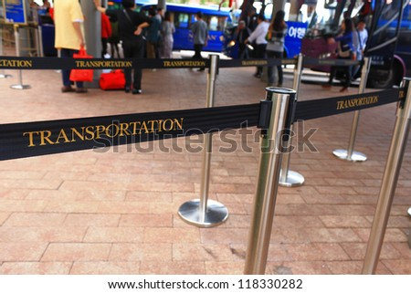 The public control barriers at bus stop - stock photo