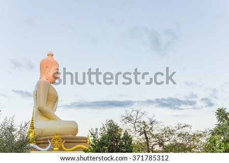 The public White buddha sculpture on blue sky background from bottom view Thailand travel concept. End of Buddhist Lent Day concept.  - stock photo