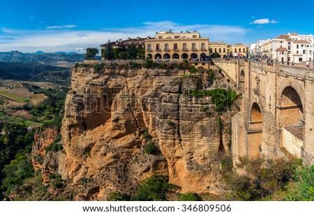 The Puente Nuevo New Bridge over Guadalevin River in Ronda, Andalusia, Spain. Popular landmark in the evening - stock photo