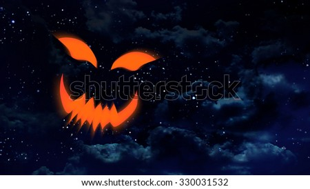 the pumpkin face laughing at night sky with star background - stock photo