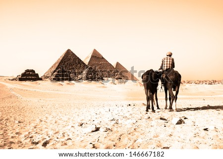 The pyramids of Giza, Cairo, Egypt;  the oldest of the Seven Wonders of the Ancient World, and the only one to remain largely intact.