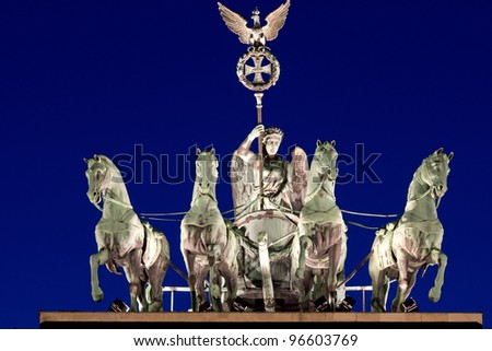 The Quadriga on top of the Brandenburger Tor in Berlin at night - stock photo