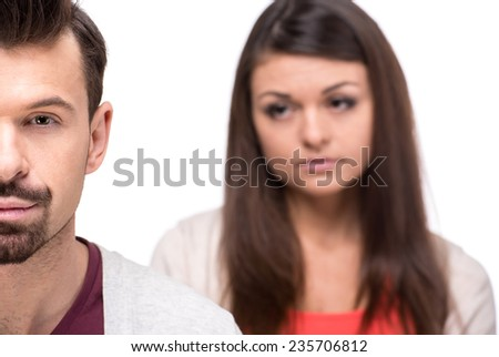 The quarrel between the young couple. White background. - stock photo