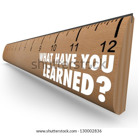 The question What Have You Learned? on a wooden ruler asking you to assess what knowledge you have attained through education, training or other life experience - stock photo