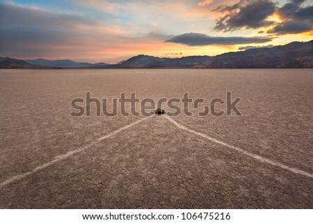 The Race Track in Death Valley National Park is home to some very mysterious and amazing traveling rocks. - stock photo