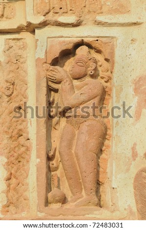 The Radha Gobinodo temple in Jaydev -Kenduli in Birbhum District of the West Bengal State in India has exquisite terracotta carvings. This part of the temple shows a Hindu god worshiping.