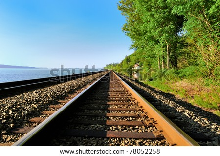 The railroad along the bay on the west coast of the USA. - stock photo