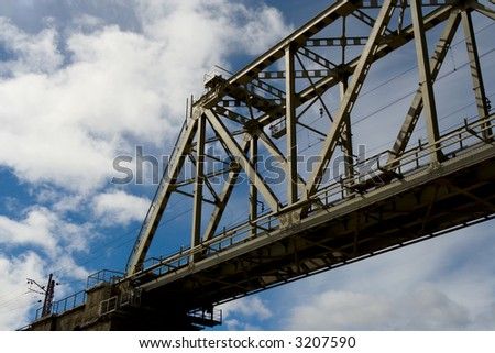 The railway bridge on a background of clouds - stock photo