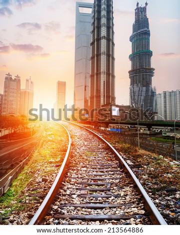 the railway go through the shanghai financial center - stock photo