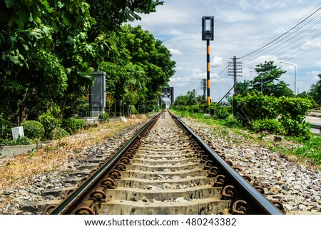 The railway of the train in Thailand with the signal post and railroad beside